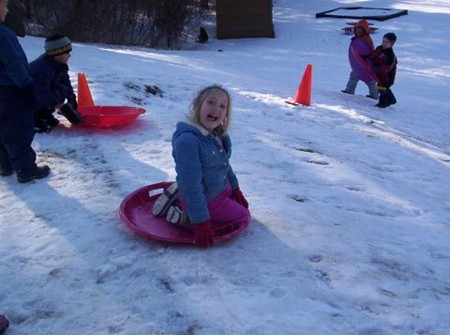 Winter fun on our sledding hill